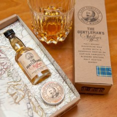 Cire à moustaches The Gentleman's Stiffener Captain Fawcett et bouteille de whisky
